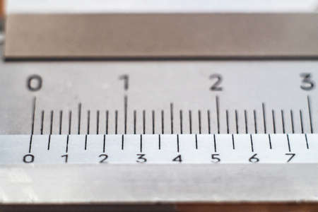 Vernier caliper close-up, scale division macro. Imagens