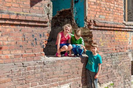 Three children in a destroyed house are hiding from military conflicts, refugee children have suffered from the destruction of terrorist acts of violence. Submission photo.