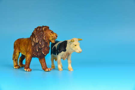 Toy animals made of plastic on a blue background, baby little animals.