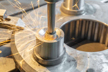 Internal processing of the hole on the grinding machine, precise finishing. Stock Photo