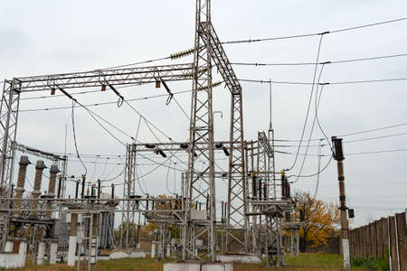 High voltage transformer at an electrical substation of the city power grid. Power wires with high voltage.