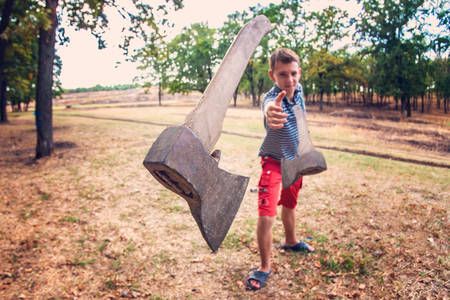 A man throws an ax at the camera, selective focus, combined photo.