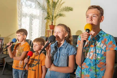 Children participate with a microphone, recite poems, recitation, sing songs.