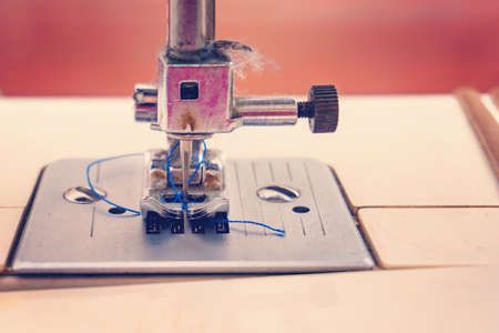 Sewing machine, closeup needle and presser foot with holder.