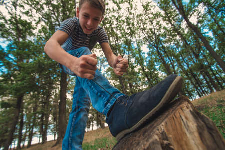A guy lacing shoes, wide-angle photo, bottom view.