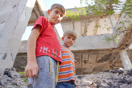 Poor and dirty street children living on an abandoned construction site. Stok Fotoğraf