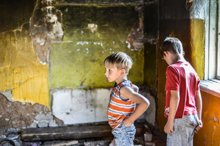 Children in a burnt house lost their homes as a result of hostilities and natural disasters. Stok Fotoğraf