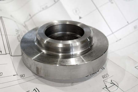 Polished adapter plate on a technical drawing in the industry.