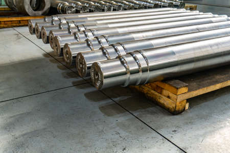 Shafts in the warehouse after turning at the factory. Reklamní fotografie