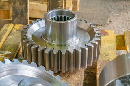 Gears on the rack after manufacturing at the manufacturing plant. Gear cutting in mechanical engineering.
