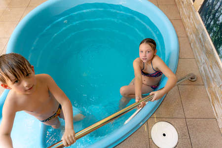 Children in the home pool bathe in the water