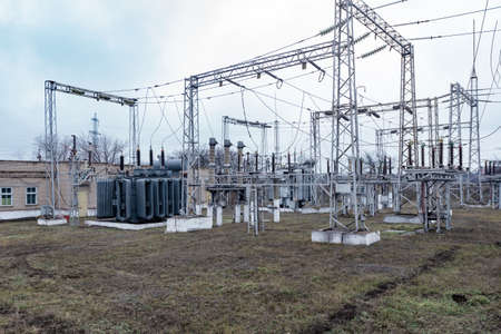 High voltage urban electrical substation with high voltage wires and transformers 스톡 콘텐츠