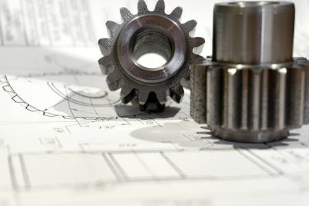 The gear after manufacturing on the gear cutter lies on the technical drawing