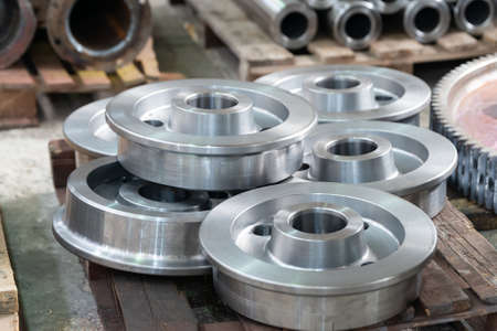 Metal wheels for transmission trolleys, wagons, after turning. 스톡 콘텐츠