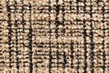 Texture of dark beige fabric close-up, fabric texture.