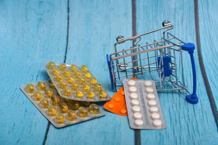 Inverted trolley and pills and medicines lie nearby, the concept of the uselessness and futility of treatment.