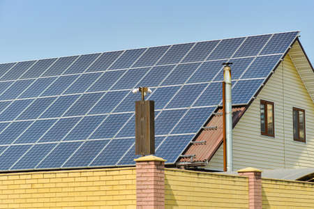 Solar panels for converting sunlight into electrical energy on the roof of a private house