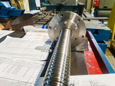 Ball screw in a repair shop for the repair of mechanical equipment of a cnc metalworking machine Reklamní fotografie