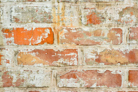 Texture of old brick with white paint, brickwork seam on a brick wall