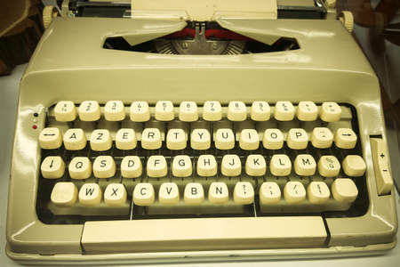 Old mechanical typewriter with a sheet for printing in a museum of an educational institution