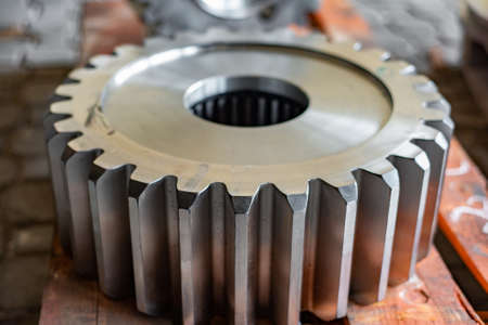 Big gear after milling on a gear cutting machine, finished goods warehouse of machine-building production.