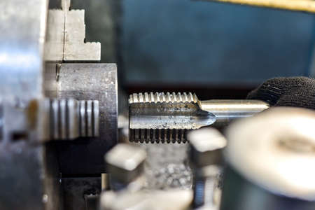 Tapping on a lathe, the tap cuts the hole by applying pressure from the tailstock Zdjęcie Seryjne