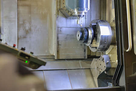 CNC machining center. The rough part after heat treatment is installed in a chuck for further cutting on a cnc machine