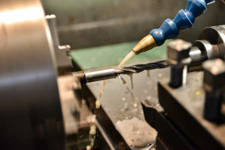 Drilling a hole in a part with a drill on a lathe