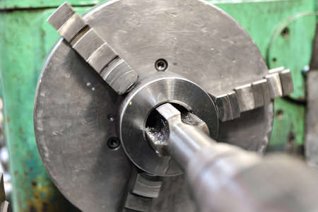 Tapping on a lathe, the tap cuts the hole by applying pressure from the tailstock
