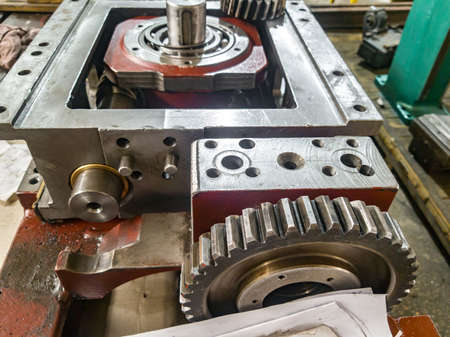 Gearbox assembly in the workshop. Mechanical transmission with gears and flywheel