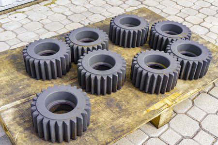 Gear after heat treatment and hardening on a wooden rack, improving the hardness of the metal. Zdjęcie Seryjne