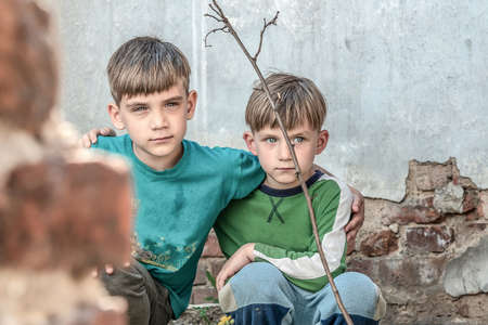 Two brothers are orphans, hiding in an abandoned house, frightened by the disaster and hostilities. Submission photo.
