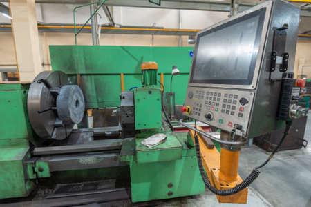CNC machine and control panel at a machine-building enterprise. 版權商用圖片