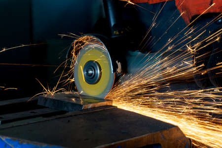 Metal cutting with a manual grinder at a machine-building enterprise.