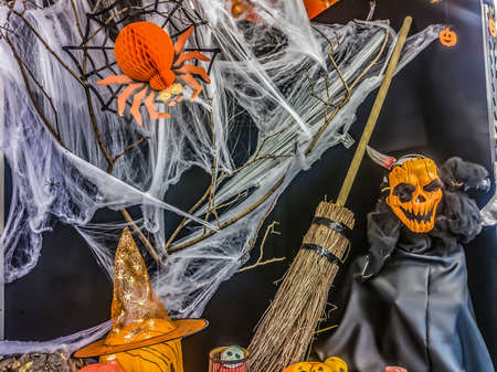 Halloween witch, broom and spider, holiday party scare props. 版權商用圖片
