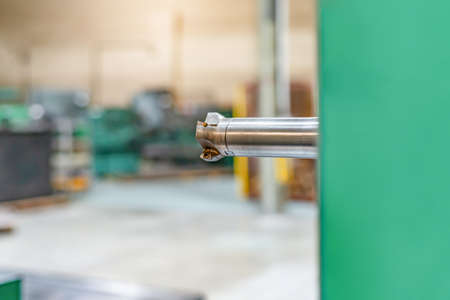 Spindle with end mill on the mandrel of a CNC machine.