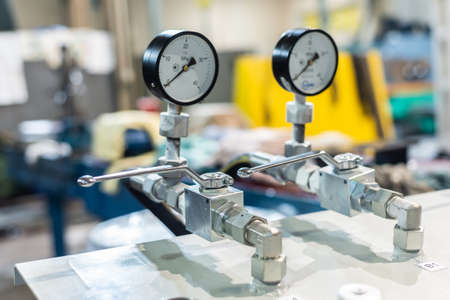 Pressure gauge in the hydraulic control system for powering equipment and machine tools.