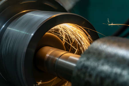 Grinding work of the workpiece on a cylindrical grinding machine.