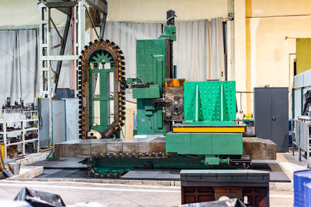 CNC metalworking machine at a production site in a factory. Imagens