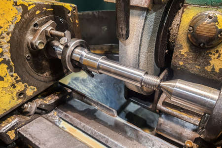 Work piece with an abrasive stone installed in the centers of a grinding machine.