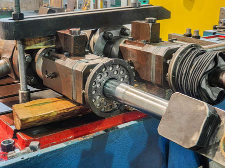 Hydraulic cylinder rod disassembled for repair.