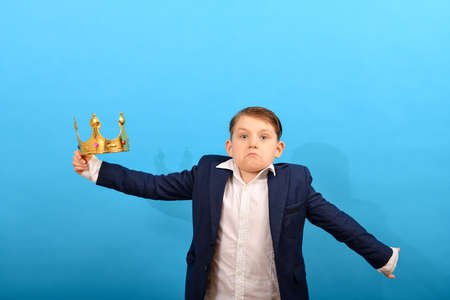 The boy got the golden crown, but he doesn't know what to do with it.