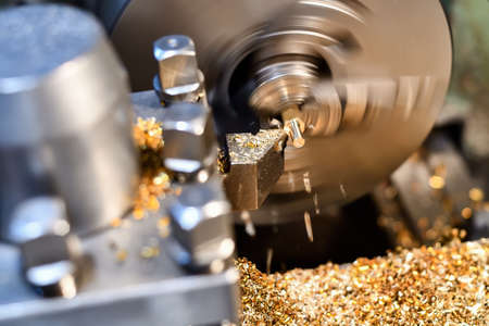 Processing of non-ferrous metal by cutting on a lathe. Manufacturing of parts from bronze and brass. Standard-Bild