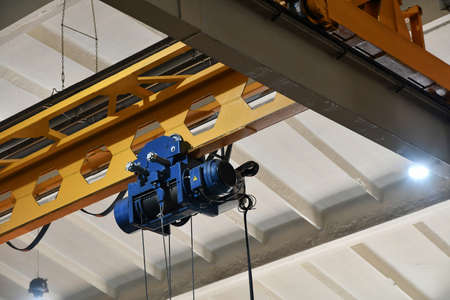 Electric drive of an overhead crane in a workshop at a metalworking production.