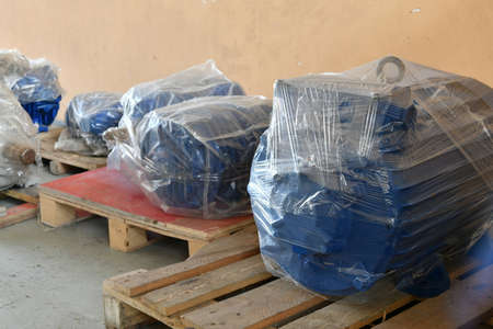 New electric motors are wrapped with packaging in the warehouse.