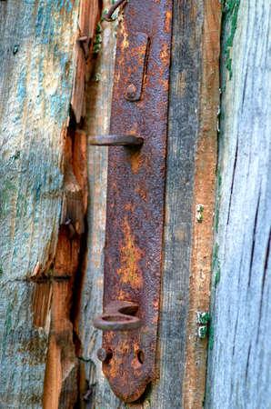 old wooden door with rusty lock
