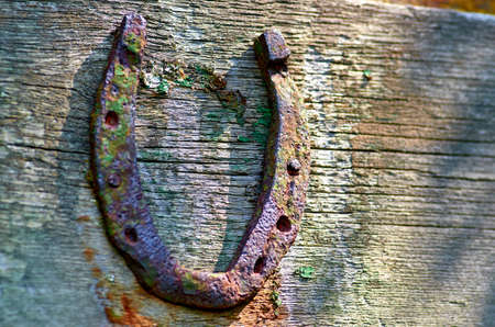 old rusty horseshoe on the wall Stockfoto