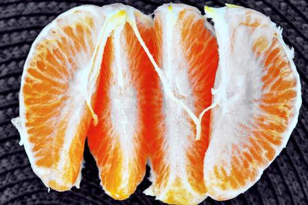 Peeled slices of citrus fruit