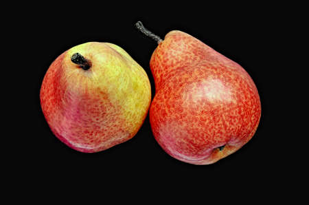 Red pears on a black background