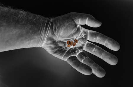 hand, isolated, white, medicine, key, business, hold, person, finger, black, people, object, concept, fingers, hold, abstraction, negative, coffee, grains, handful Zdjęcie Seryjne